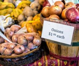 potatoes and onions on display at market