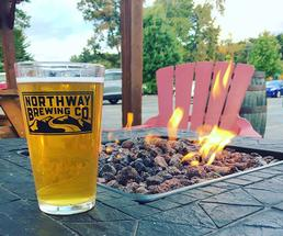 beer in front of a firepit