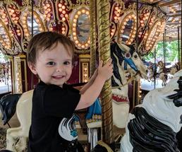 kid on merry go round