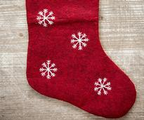 a red stocking with white snowflakes