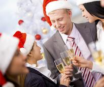 people wearing Santa hats and drinking champagne