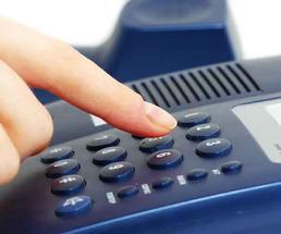 Hand dialing a black landline phone