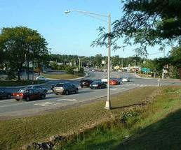 A major intersection with cars stopped at a red light in Queensbury NY