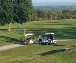 people golfing and two golf carts