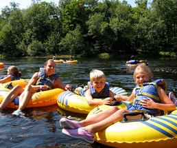 people lazy river tubing