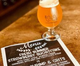 glass of beer with food menu