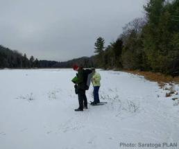 people snowshoeing in the palmertown conservation area
