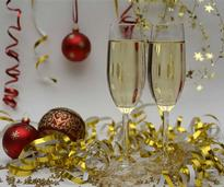 two champagne glasses among decorations
