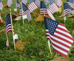 small flags in the ground