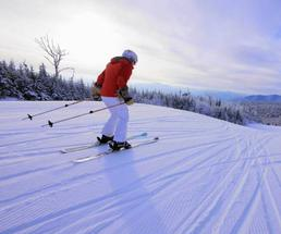 downhill skier with red jacket