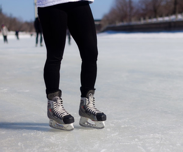 person skating on hockey skates