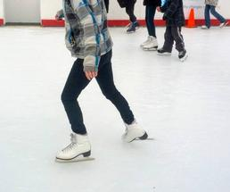 close up of people ice skating