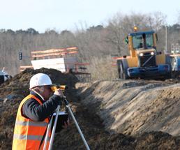 engineer surveying on job site