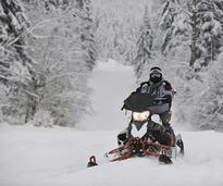 man on a snowmobile
