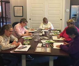 women doing a craft at the conkling center