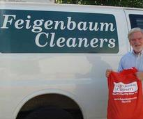 dry cleaner van and man holding laundry bag
