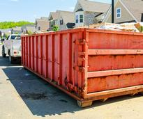 dumpster in front of a house