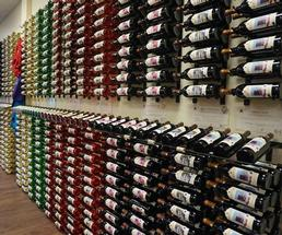 wall of wine racks and bottles