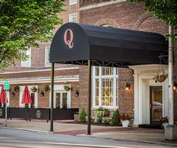 front entrance of the queensbury hotel