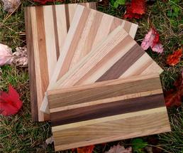 wooden cutting boards on the grass