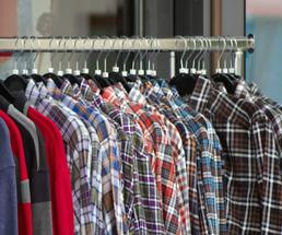 rack with plaid shirts