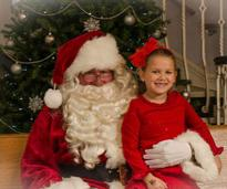 a girl with santa claus