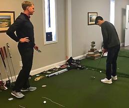 man practicing golf indoors