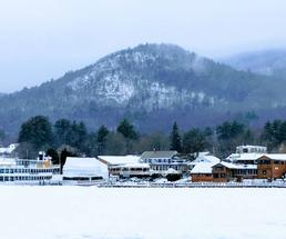 Lake George with lake, houses, mountain in winter