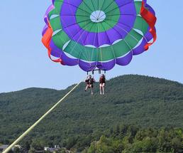 people parasailing over lake george