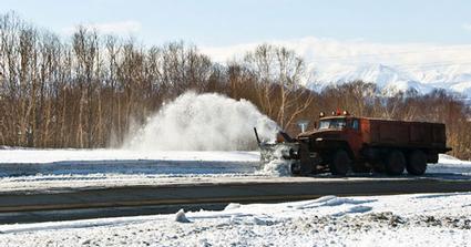 snowplow clearing highway