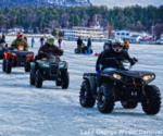 people riding atvs on frozen lake george