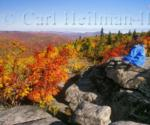 person on rocky summit in fall
