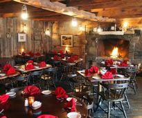 dining room with fire place at the anvil inn