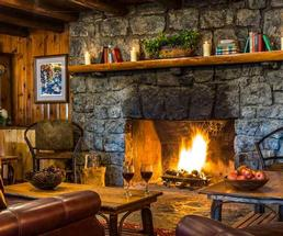 large stone fireplace in rustic lounge