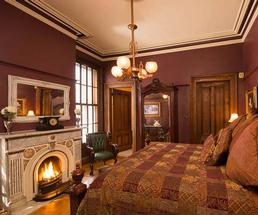 a bedroom with a fireplace