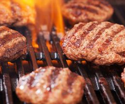 meat patties on a grill