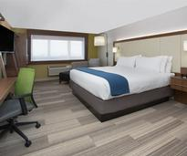 hotel room with two double beds with white linens