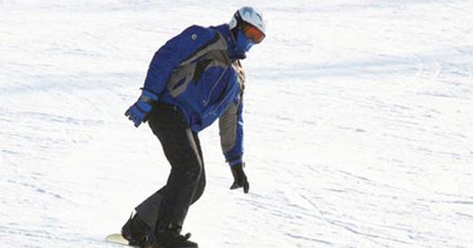 snowboarder in blue winter gear