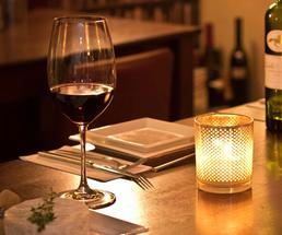 a dimly lit restaurant, place setting
