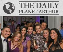 "people attending a gala with ""daily planet arthur"" as the header"