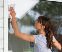 woman cleaning a sliding glass door