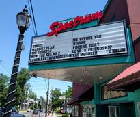 Spectrum theater sign with movie listings