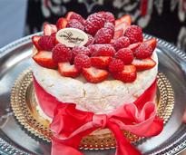 a cake with raspberries and strawberries