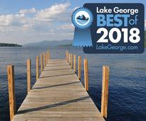 a dock on lake george with the best of 2018 badge