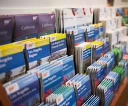 travel brochures in a rack