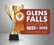 golden cup with region's best badge