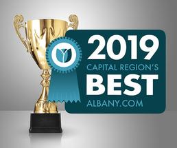 trophy with 2019 capital region's best badge