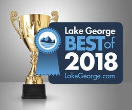 golden cup with best of lake george badge