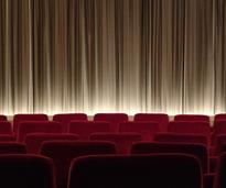 an empty theater with red curtain