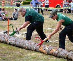 two men cutting a log